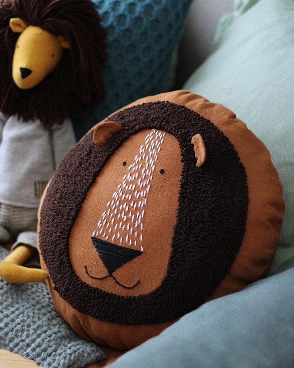 Lion cushion in rust colour