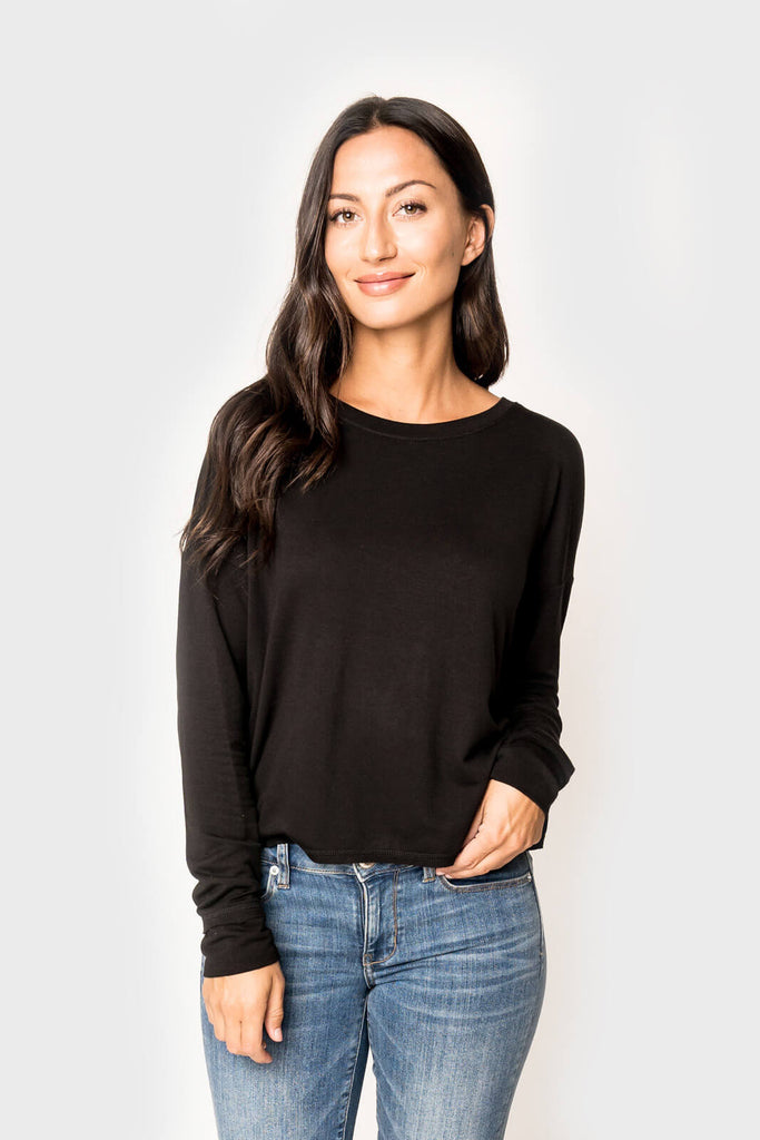 Woman wearing a super soft knit pullover long sleeve sweatshirt in color Black