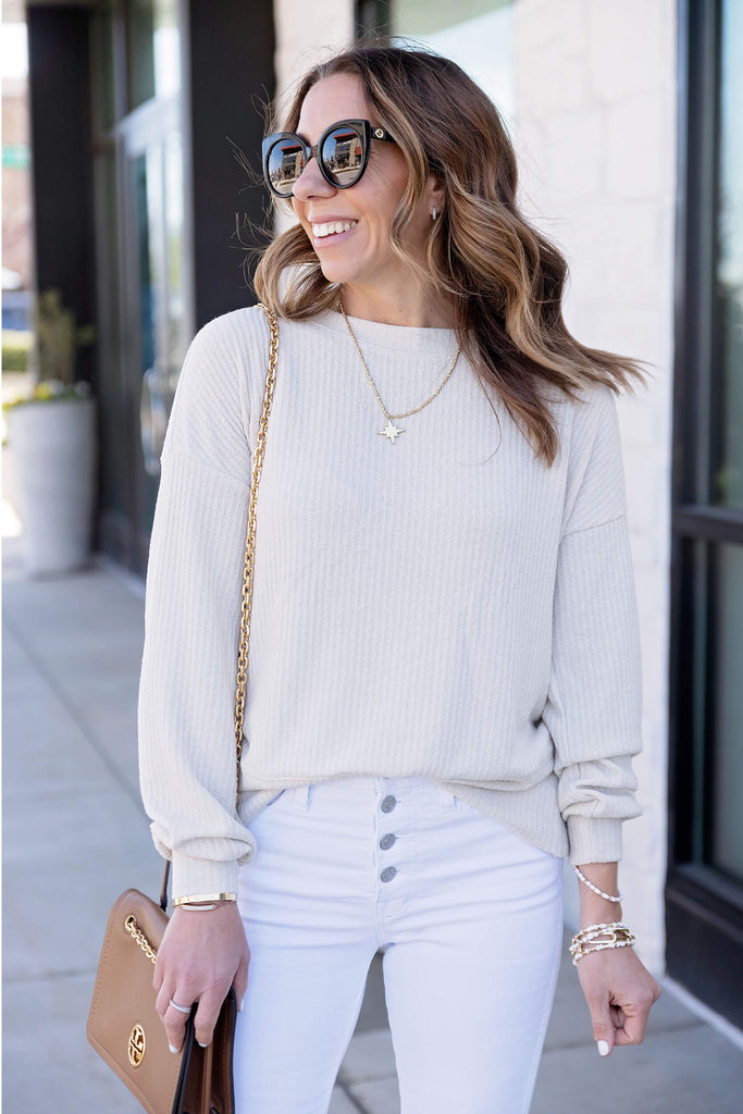 Women wearing With a Twist Wrap Back Sweater Top in Natural