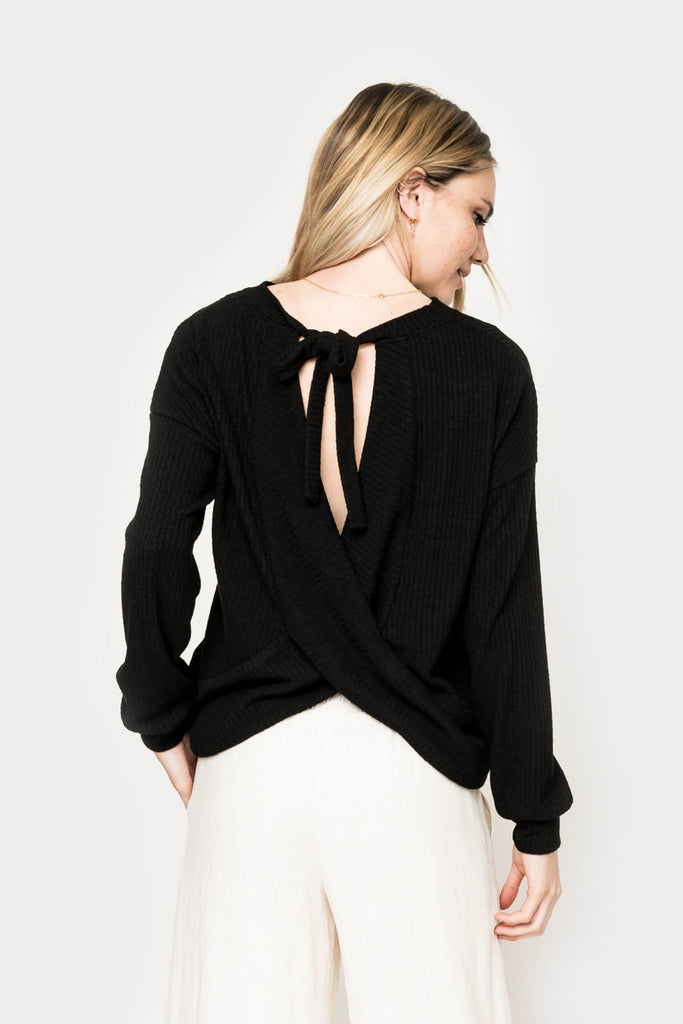 Women wearing With a Twist Wrap Back Sweater Top in Black