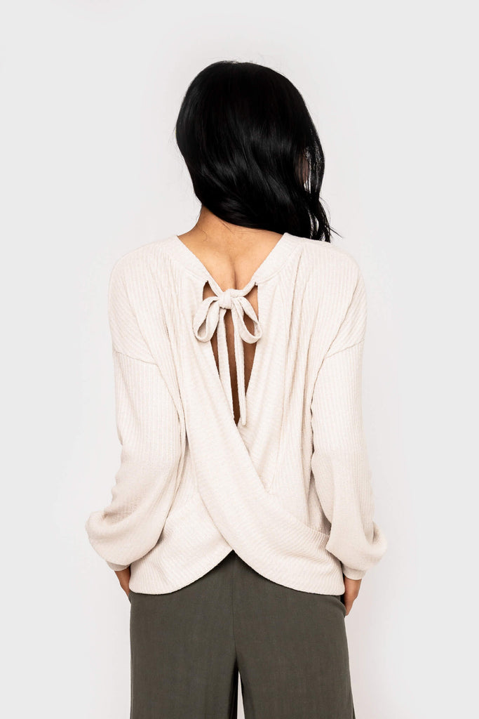 Women wearing With a Twist Wrap Back Sweater Top in Seashell