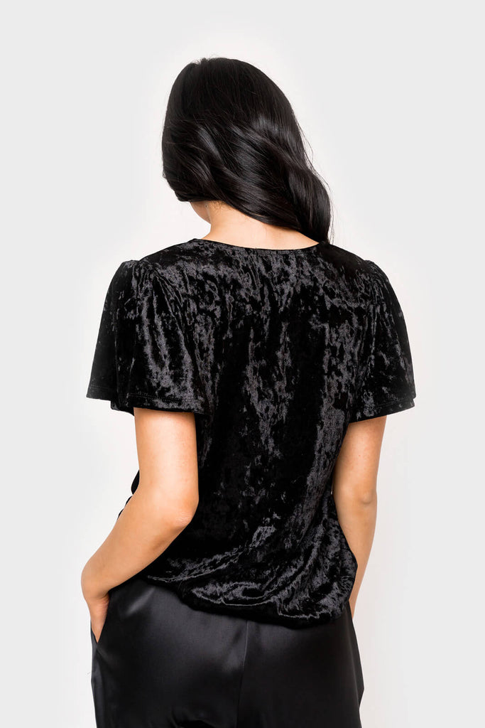 Women wearing The Recruiter Mom Crushed Velvet Flutter Sleeve Top in black