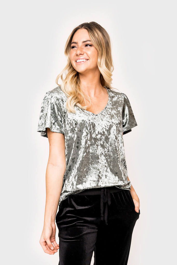 Women wearing The Recruiter Mom Crushed Velvet Flutter Sleeve Top in olive
