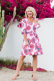 Cassie Sugarplum wearing Blissful Blouson Sleeve V-Neck Dress in Floral Medallion