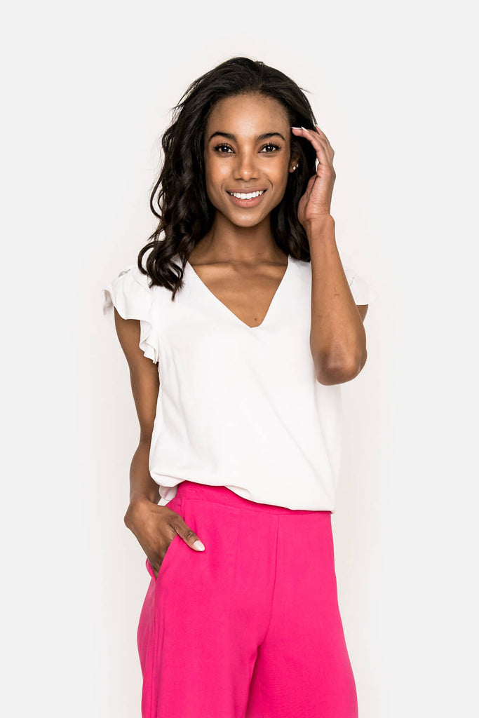 Women wearing Sunnyside Ruffle Sleeve V-Neck Top in White