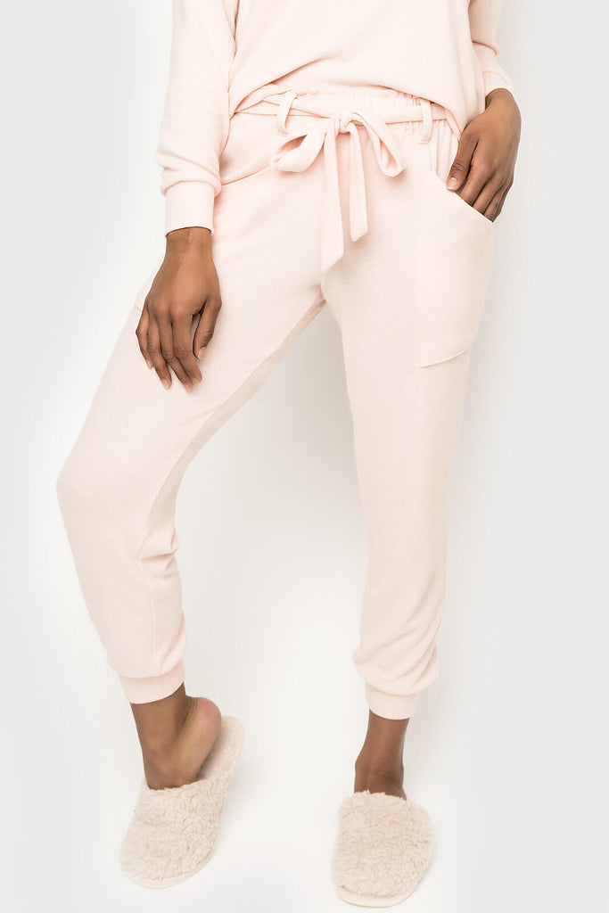 Women wearing Cabin Life Cozy Fleece Belted Jogger in Soft Coral
