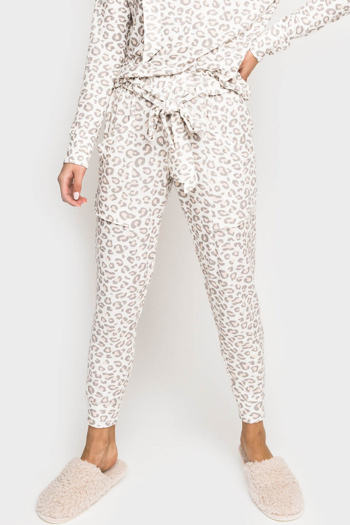 Women wearing Cabin Life Cozy Fleece Belted Jogger in Soft Cream Coral Animal