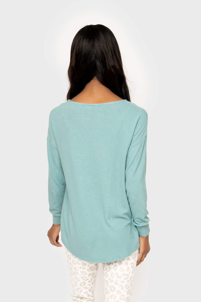 Women wearing Cabin Life Cozy Fleece V-Neck Tunic Top in Aquifer