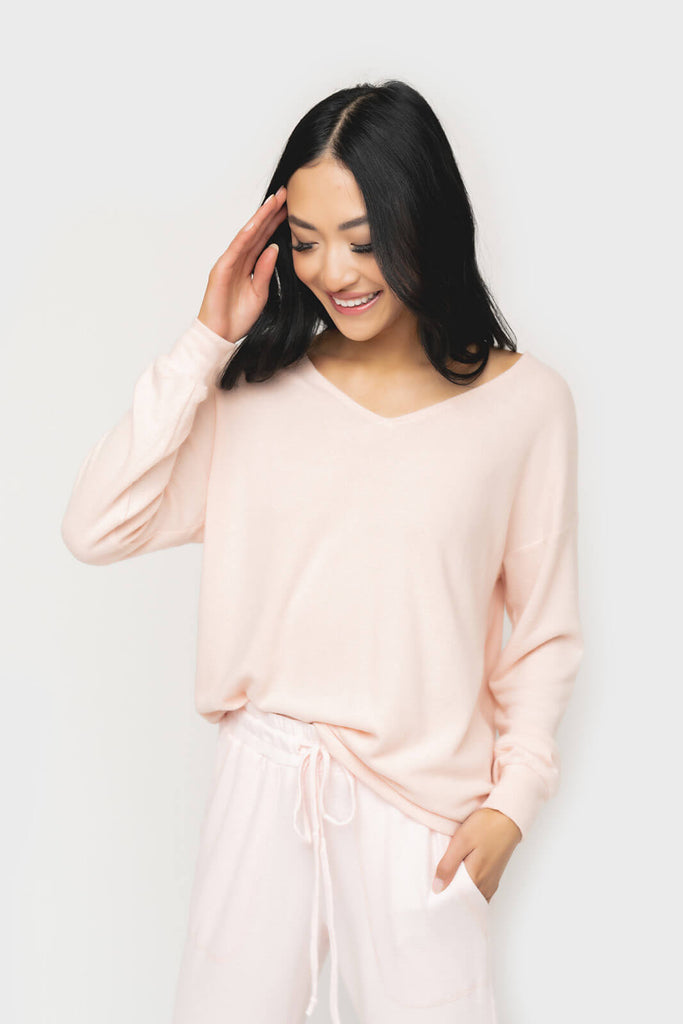 Women wearing Cabin Life Cozy Fleece V-Neck Tunic Top in Soft Coral
