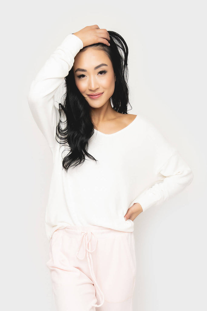 Women wearing Cabin Life Cozy Fleece V-Neck Tunic Top in soft cream