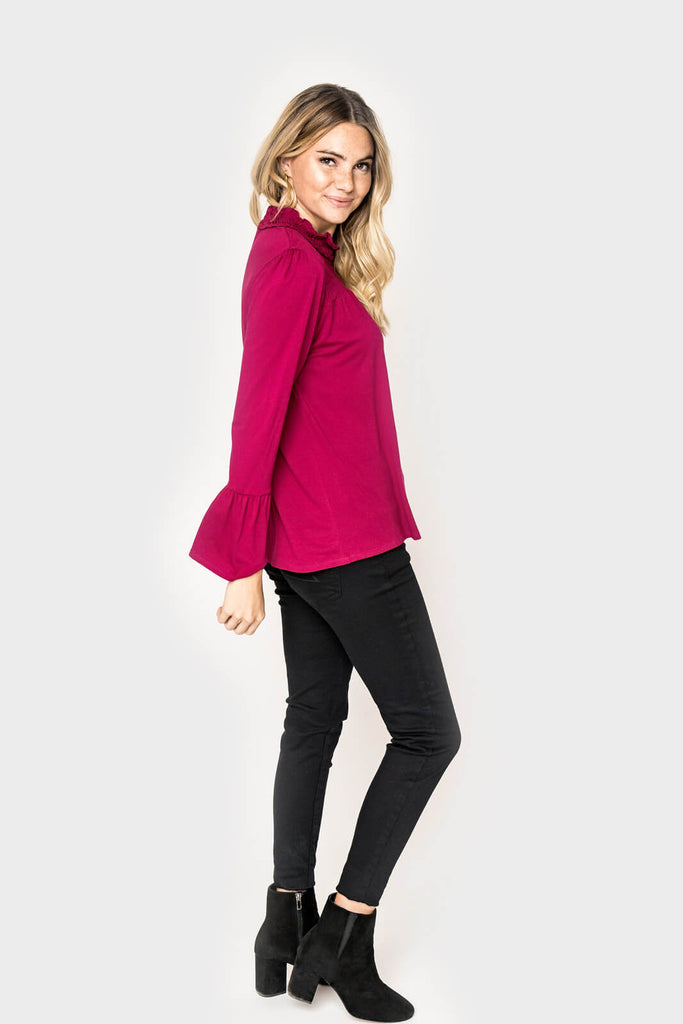 Women wearing Smocked Yoke Bell Sleeve Top in pomegranate