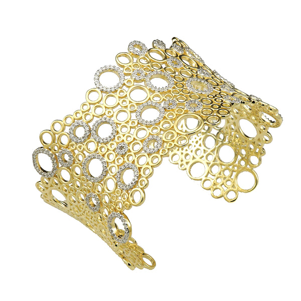 A gorgeous circle motif 14kt gold plated bangle in yellow and white