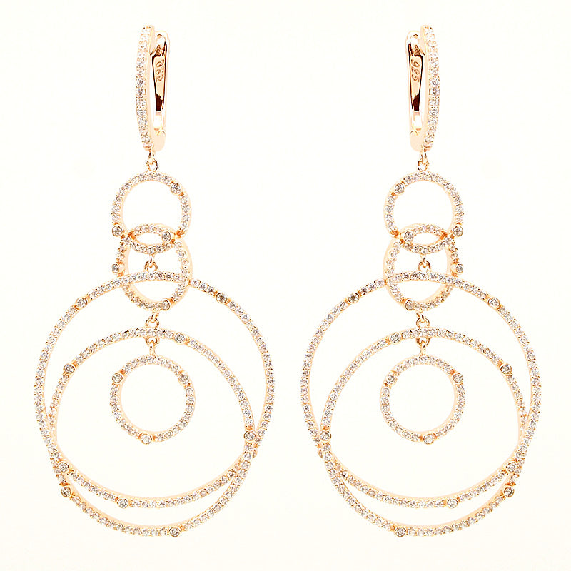 Gorgeous circular dangling 14kt gold plated earrings.