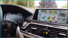 Load image into Gallery viewer, Watching Video In Motion on screen in BMW car