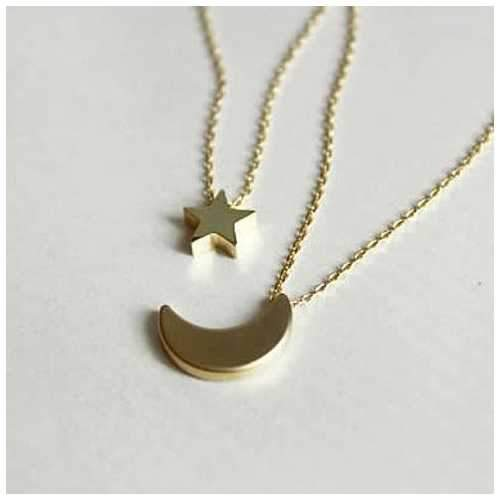 Golden Moon and Star Charms on a Layered Chain Necklace
