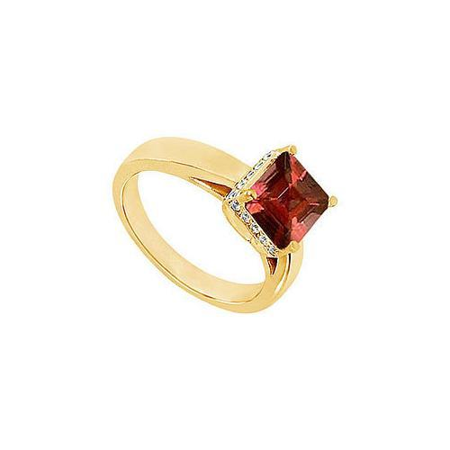 Garnet and Diamond Ring : 14K Yellow Gold - 0.83 CT TGW