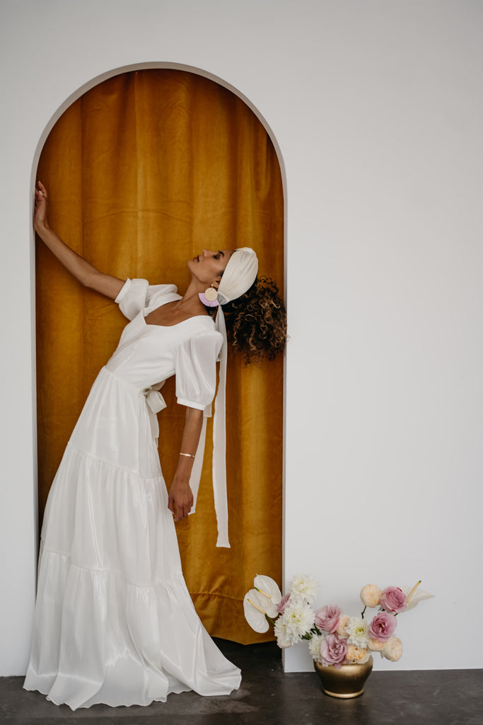 Zoe Rowyn Bridal modern wedding dress with puff sleeves and open back