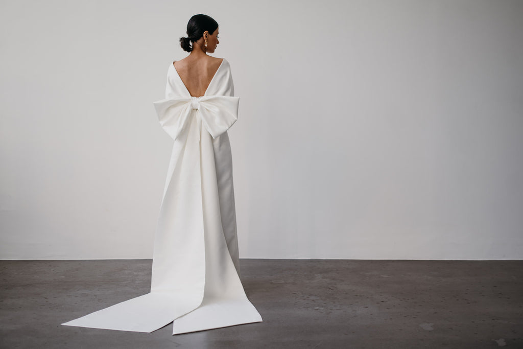 Zoe Rowyn off-the-shoulder modern bridal gown with oversized bow
