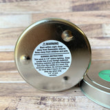 Pine Cone Soy Wax Candle 4 oz bottom of candle with warning label