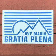Load image into Gallery viewer, Ave Maria Gratia Plena Rectangle 3 x 2 Sticker against red backdrop