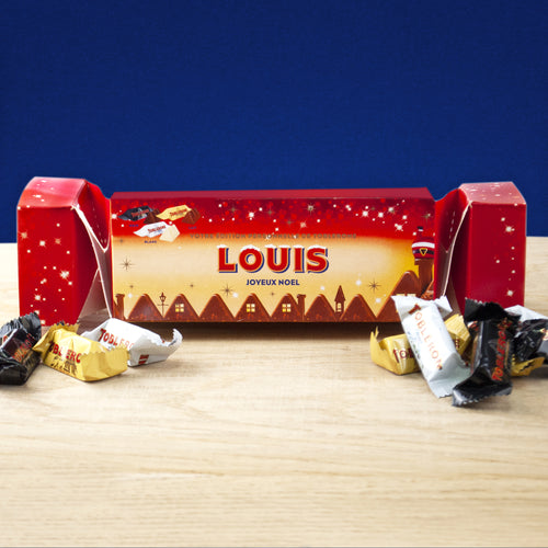 Christmas scene Toblerone cracker filled with 25 mini milk, dark and white chocolate Toblerones