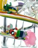Close up view of Empire Glassworks Land of Ooo Mini Water Pipe showing characters from Adventure Time sliding down a rainbow.