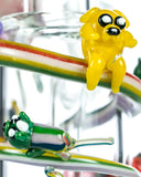 Close up view of Characters on Empire Glassworks Land of Ooo Mini Water Pipe showing characters from Adventure Time sliding down a rainbow.