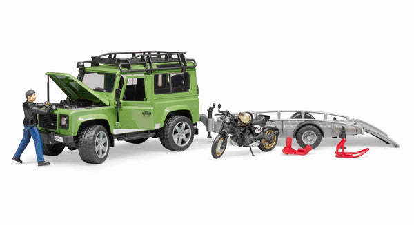Land Rover Defender Station Wagon with trailer, Ducati Scrambler Caf Racer and rider