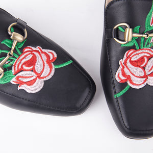 Cheska Embroidered Floral Flat Mule In Black Faux Leather