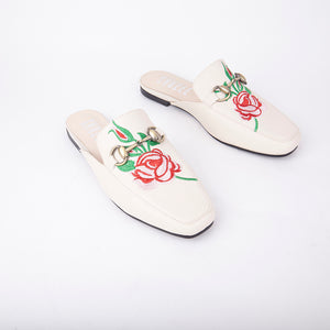 Cheska Embroidered Floral Flat Mule In Nude Faux Leather