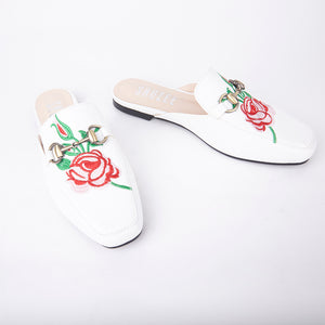 Cheska Embroidered Floral Flat Mule In White Faux Leather