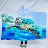 Turtle Swimming On The Surface Of Ocean Hooded Blanket