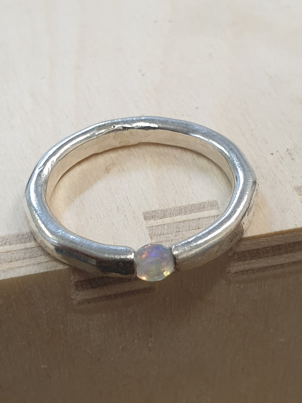 Opal tension ring