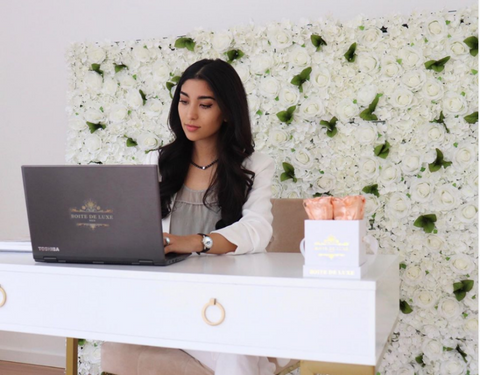 Mandana, Founder of Boite de Luxe working in her home office featuring the Flower Wall and Petite Square collections.