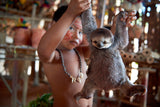 Indigenous Boy Holding Baby Sloth