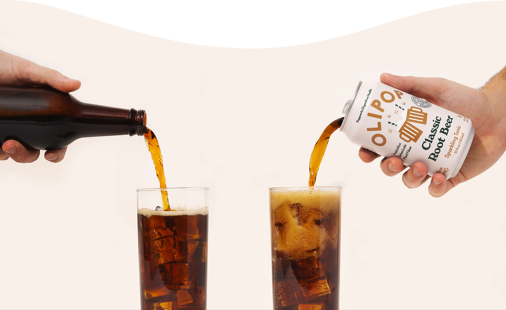 Olipop Root Beer being poured into a glass over ice next to a bottle of traditional root beer.