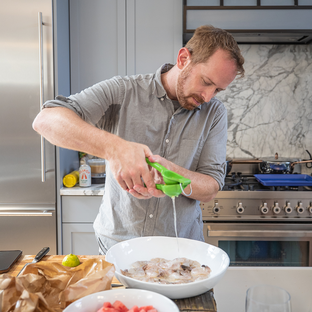 Chef Daniel Skurnick preparing and cooking ingredients for his dish