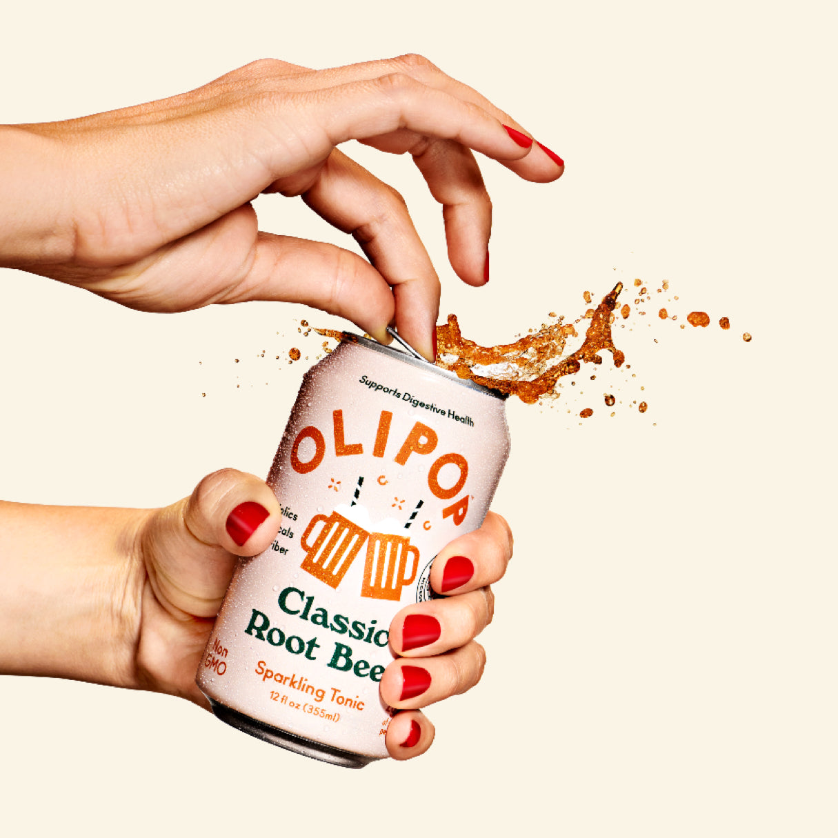 Olipop Root Beer being uncorked by female hands