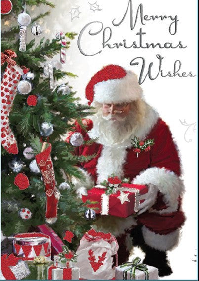 CHRISTMAS CARD-SANTA AT TREE WITH GIFTS Retail: $3.99 Unit pack 4 Inside: The festive season is upon us...