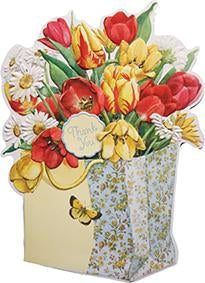 Pretty gift bag filled with red and yellow tulips. Thank you card from Carol Wilson Fine Arts. Inside: From the bottom of my heart! Retail: $4.25 Unit pack of 6