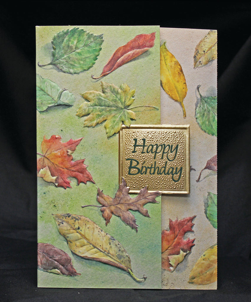 Falling Autumn leaves male embossed, die-cut birthday card from Carol Wilson Fine Arts. Inside:          Gathering up wishes for a wonderful day. Retail: $4.25 Unit pack: 6