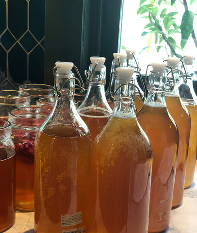 Bottled plain Kombucha and jars with flavour ready to sit for two days