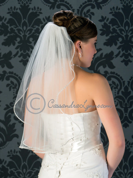 Elbow length pearl and rhinestone edge wedding veil