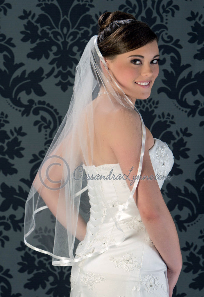 Satin ribbon waist bridal veil.