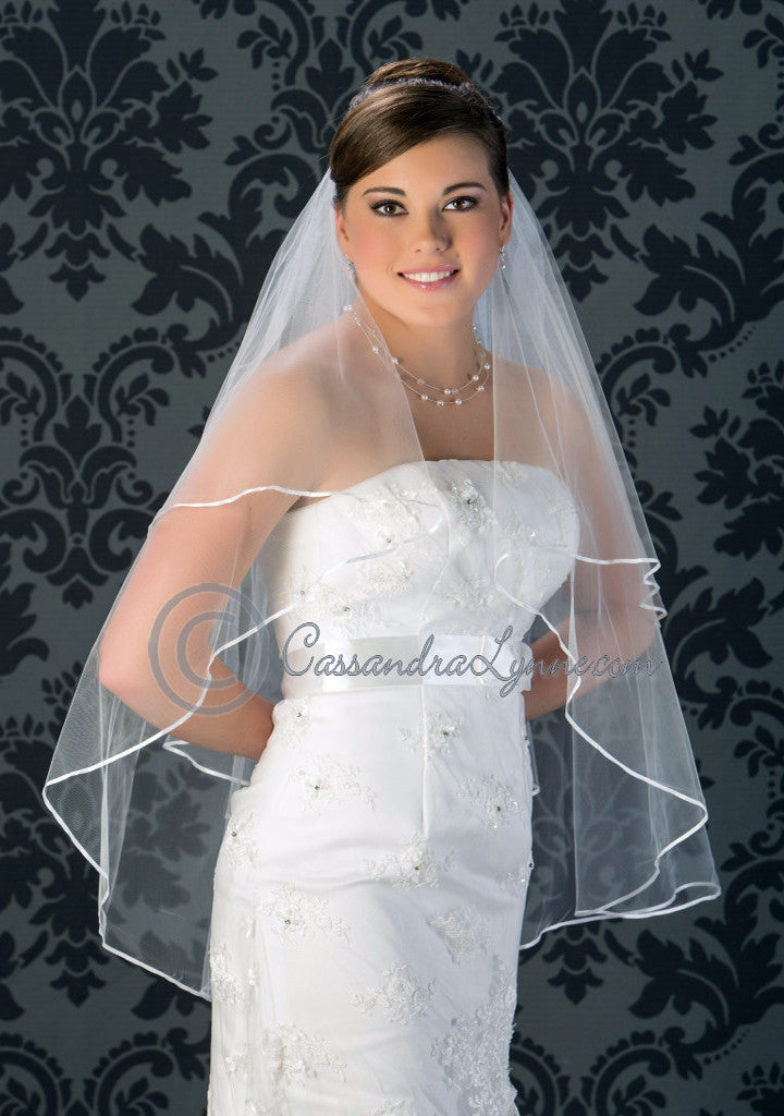 Two tier satin ribbon edge fingertip veil
