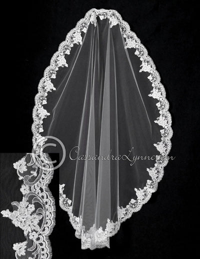 Mantilla with 5 inch alencon lace.