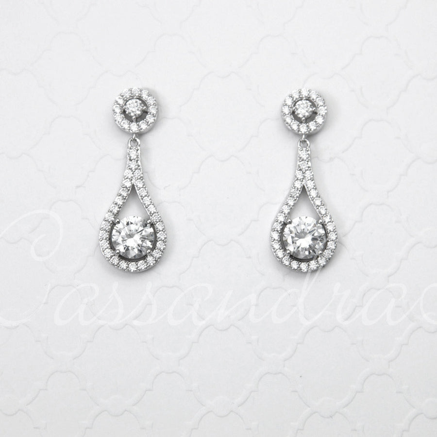 earrings on photo day portrait close of room in up beautiful a elegant her putting wedding bride