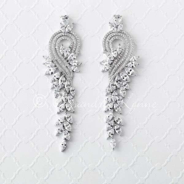 Elegant CZ Earrings with Marquise Drape and Swirl Design