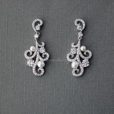 Pearl CZ Earrings with a Swirl Design
