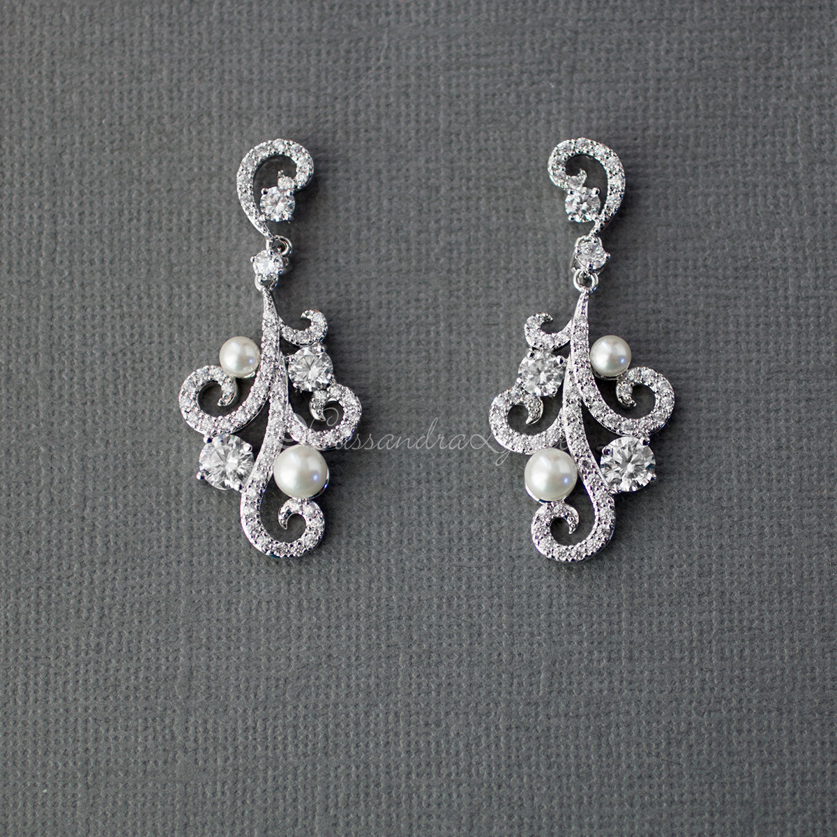 Clip On Pearl CZ Earrings with a Swirl Design